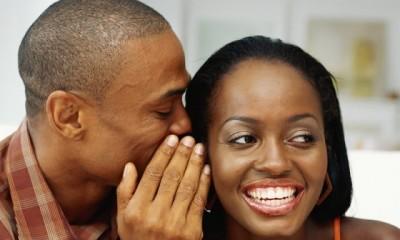 black-man-whispers-to-laughing-woman.jpg